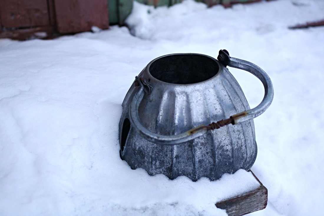 Metal tea pot in the snow