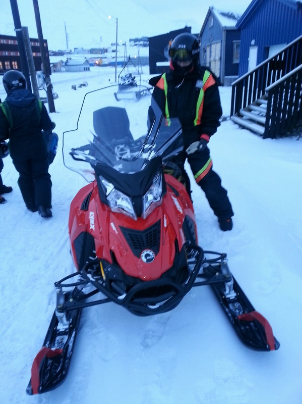 Researcher and snow mobile