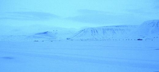 Mining remains black against snowy landscape